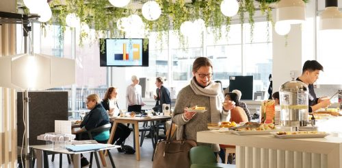 Bright event space with people eating