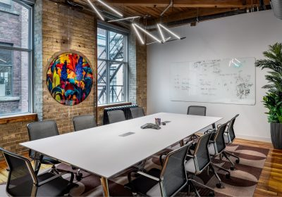 Meeting room with colourful artwork at Workplace One King East