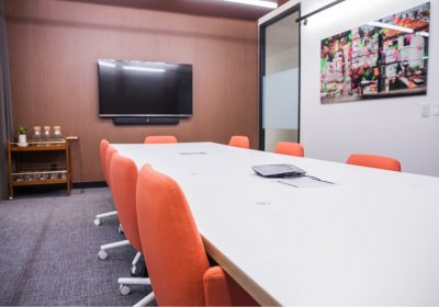 Large meeting room with orange chairs at Workplace One Bay-Bloor