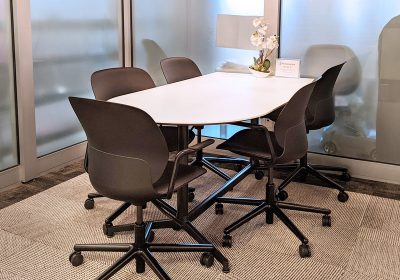 Small meeting room with black chairs at Workplace One King East