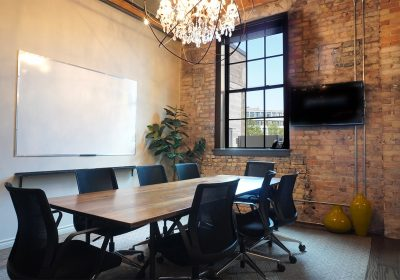 Meeting rom with brick walls and whiteboard