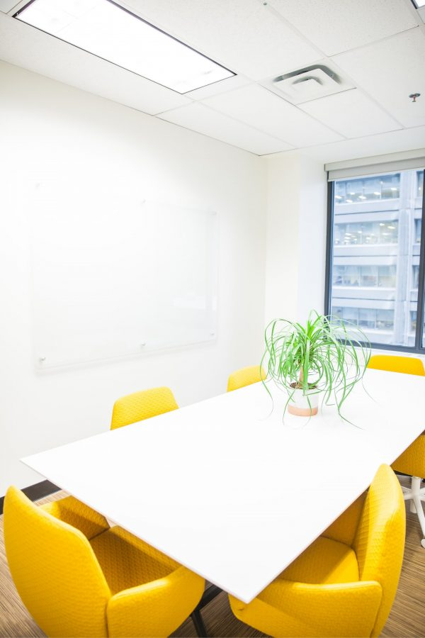 Bright meeting room with yellow chairs at Workplace One Bay-Bloor