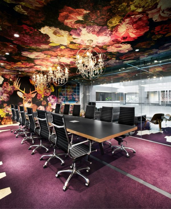Colourful boardroom with purple floor at Workplace One King West