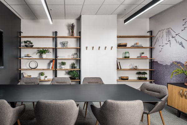 Small boardroom with grey chairs and shelves